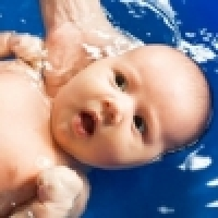 Swimming infants in age between 0-6 months